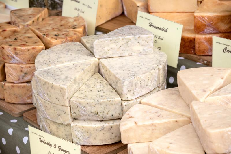 Goods for sale at Farnham Food Festival. Farnham, United Kingdom, 30th October 2017:-Cheese for sale on a stall at Farnham International Food Festival stock photography