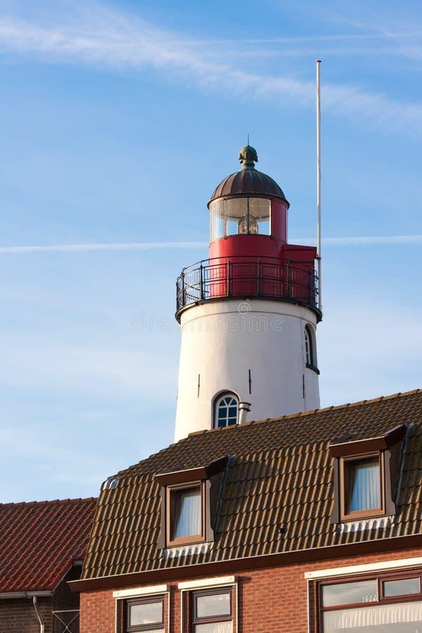 Faro blanco de la isla anterior holandesa Urk imagenes de archivo
