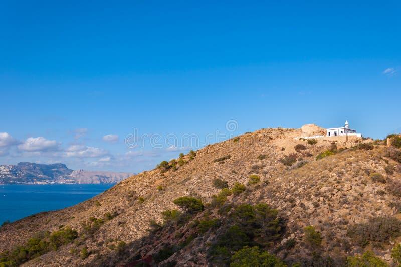 Faro de l 'Albir, en L 'Alfàs del Pi, Altea, una ciudad en la costa mediterránea de la costa blanca, un destino turístico en Esp foto de archivo libre de regalías