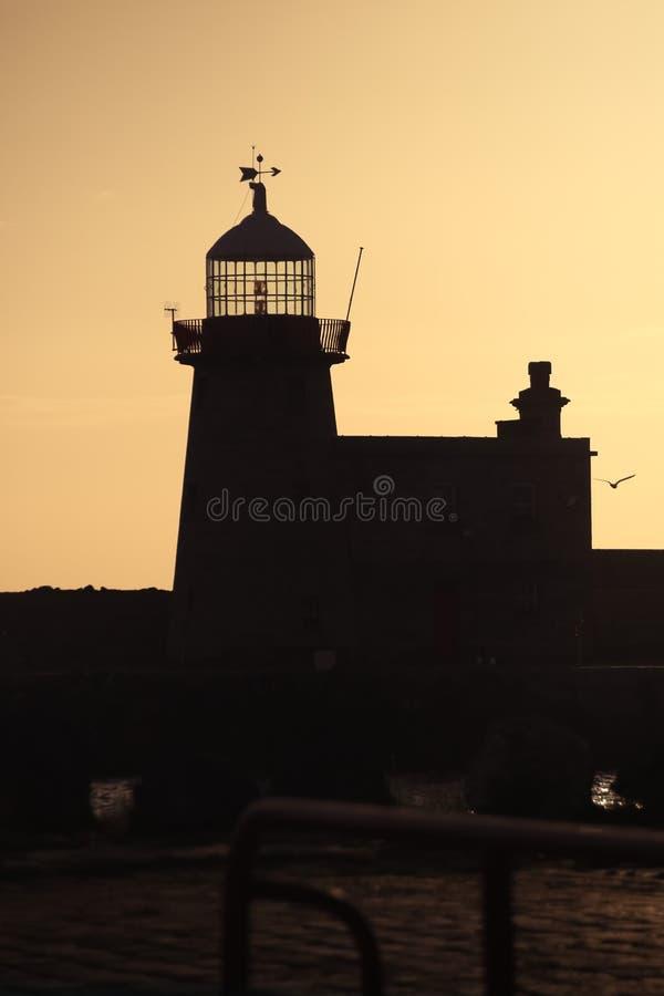 Faro del porto Howth dublino l'irlanda fotografia stock
