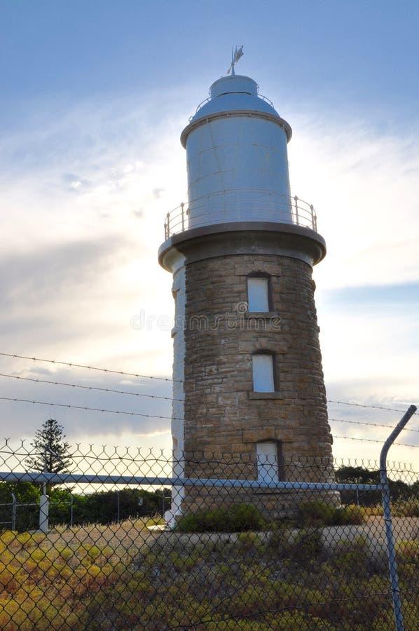 Faro del punto del leñador: Sunbacked imagenes de archivo