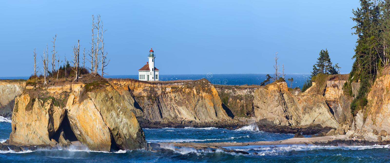 Faro di Arago del capo sulla costa dell'Oregon fotografia stock