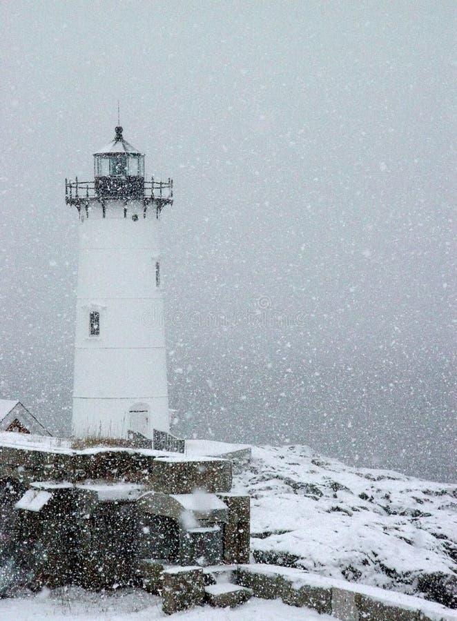 Faro di Portsmouth in precipitazioni nevose immagini stock libere da diritti
