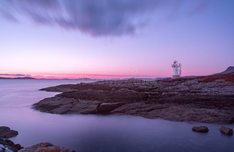 Faro di Rhue al tramonto fotografie stock