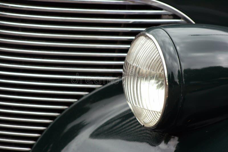 Faro e griglia classici dell'automobile immagine stock libera da diritti