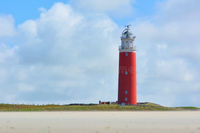 Faro en Cocksdorp en las capas de la isla Texel en Países Bajos imagen de archivo