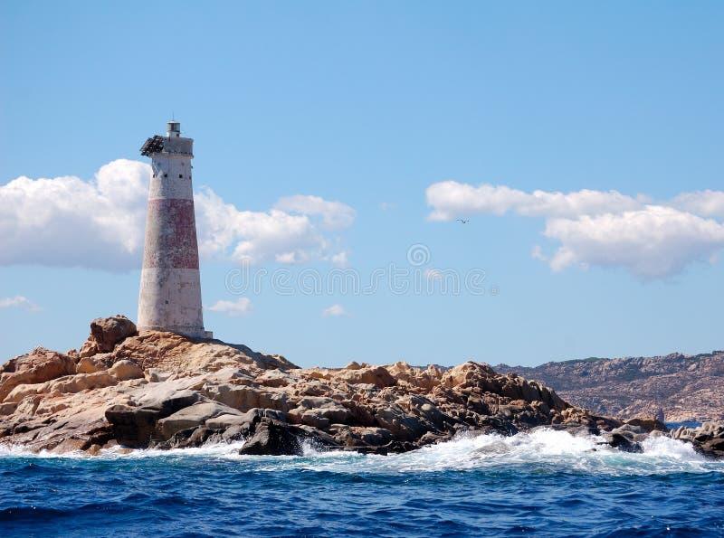Faro en roca imagen de archivo