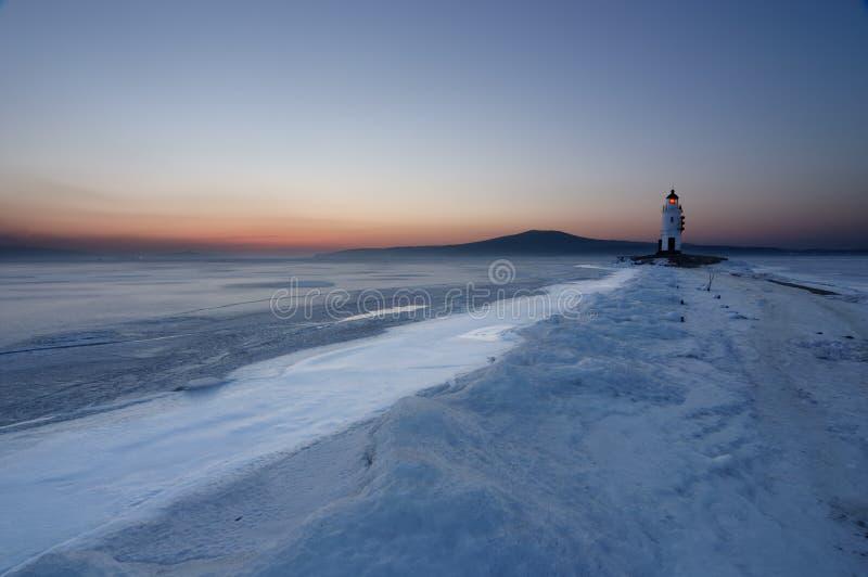 Faro in inverno immagine stock libera da diritti
