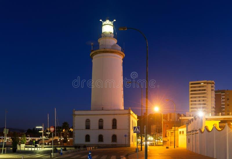 Download Faro a Malaga nella sera immagine stock. Immagine di falò - 56877609