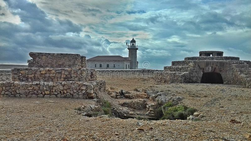 Faro Nati. Menorca. The Punta Nati Lighthouse is the closest to the center of Ciudadela of all the lighthouses in Menorca. It is one of the best places in royalty free stock photo
