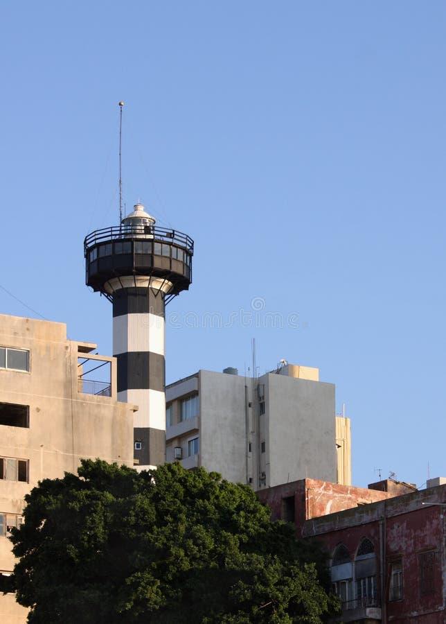 Faro nella città immagini stock libere da diritti