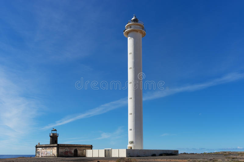 Faro Pechiguera. Also known as Lighthouse Pechiguera. At the left side you see the old lighthouse standing next to the Atlantic ocean royalty free stock images