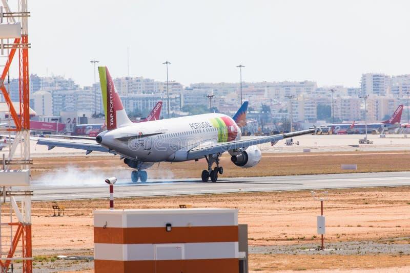 FARO, PORTUGAL - Juny 18, 2017 : TAP portugal Flights aeroplane landing on Faro International Airport. Airport royalty free stock photos