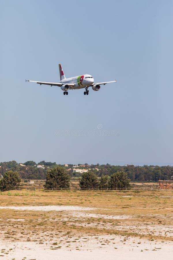 FARO, PORTUGAL - Juny 18, 2017 : TAP portugal Flights aeroplane landing on Faro International Airport. Airport royalty free stock photo
