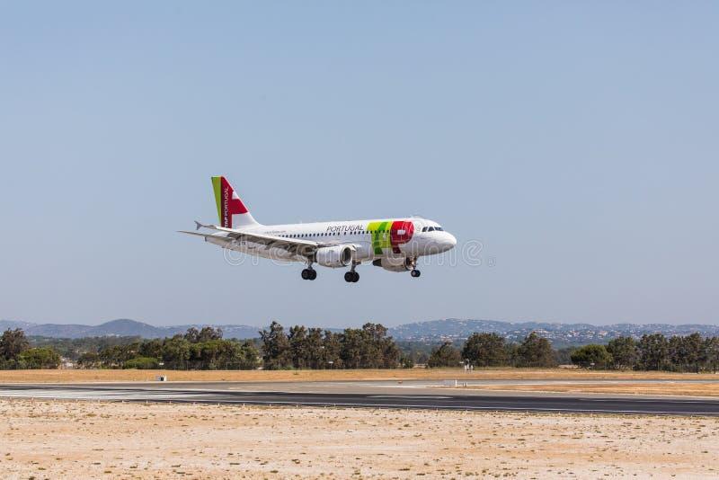 FARO, PORTUGAL - Juny 18, 2017 : TAP portugal Flights aeroplane landing on Faro International Airport. Airport royalty free stock photography