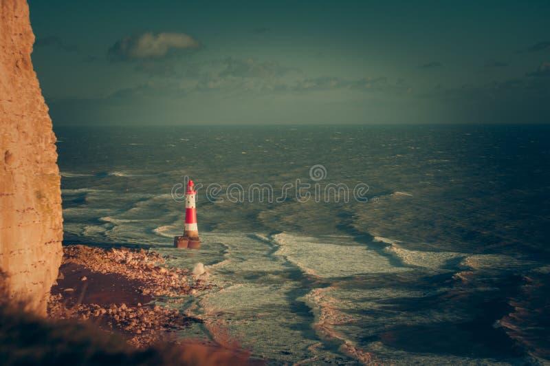 Faro principal con playas fotos de archivo