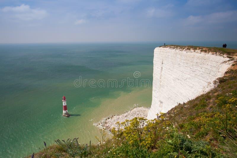 Faro principal con playas, Eastbourne, Sussex del este, Inglaterra fotos de archivo