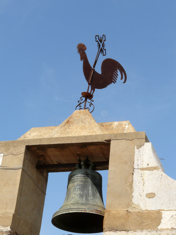 Faro's rooster on the bell. Decorated bell of Faro's cathedral, Algarve royalty free stock images