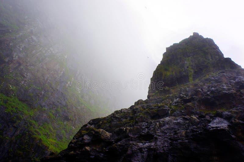 Faroe Islands boat trip, elephant rock, cliffs rocks, Denmark royalty free stock image