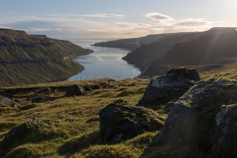 Scenic landscape at a fjord, north of Thorshavn, the Faroe Islands. The Faroe Islands in a nutshell: Beautiful, raw landscapes with mountains and fjords. Here, a royalty free stock photo