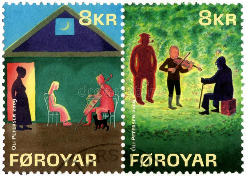 FAROE ISLANDS - 2009: shows series The lost musicians by William Heinesen. FAROE ISLANDS - CIRCA 2009: A stamp printed in Faroe Islands shows series The lost royalty free stock photography