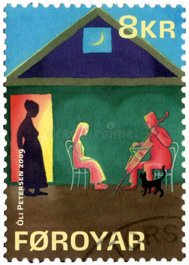 FAROE ISLANDS - 2009: shows series The lost musicians by William Heinesen. FAROE ISLANDS - CIRCA 2009: A stamp printed in Faroe Islands shows series The lost royalty free stock photo