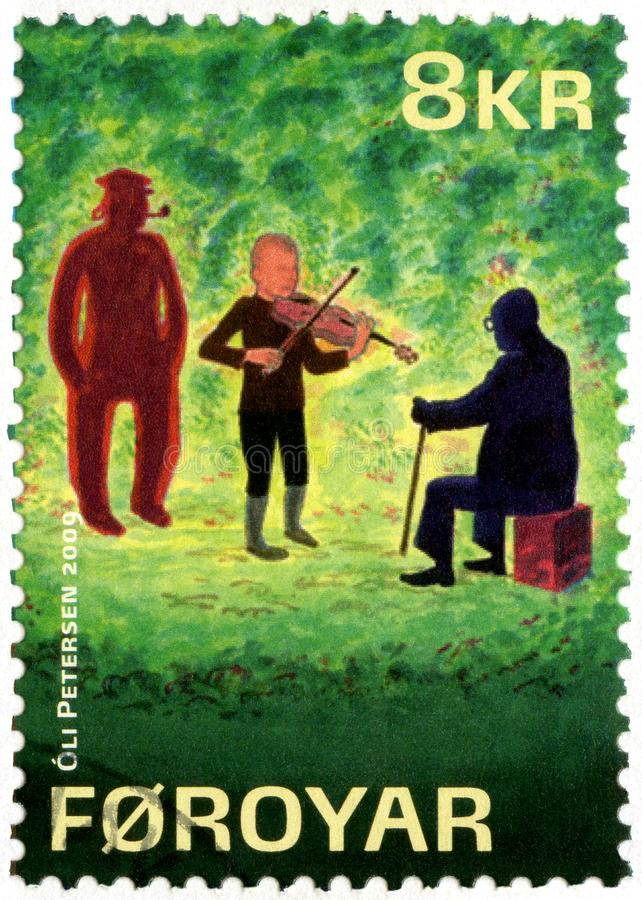 FAROE ISLANDS - 2009: shows series The lost musicians by William Heinesen. FAROE ISLANDS - CIRCA 2009: A stamp printed in Faroe Islands shows series The lost stock photography