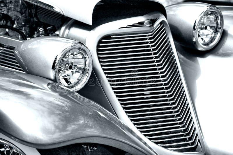Farol e grade do carro antigo fotografia de stock