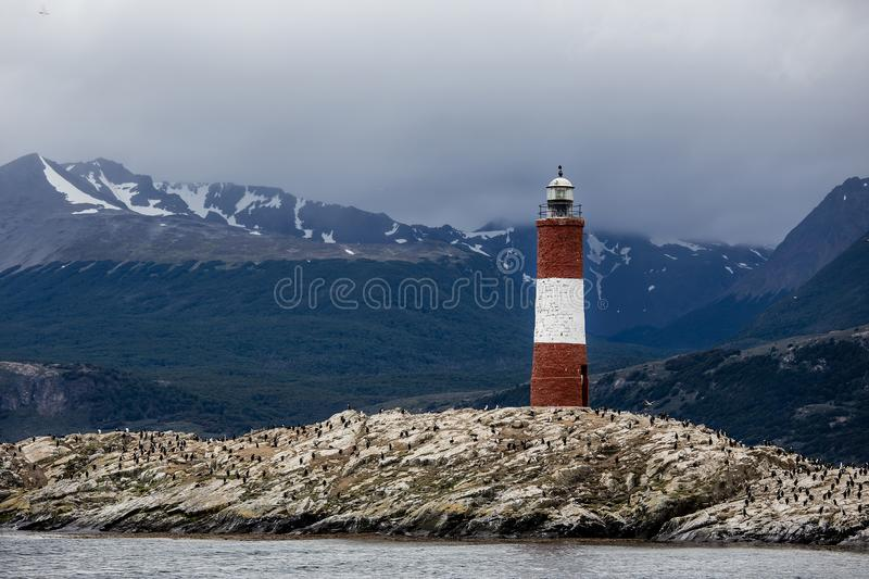Farol Les Eclaireurs, a red and white striped lighthouse on rocky island on the Beagle Channel, Ushiaia, Argentina. Red and white striped lighthouse on rocky royalty free stock photos
