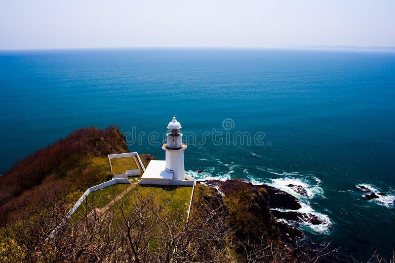 Farol no cabo Chikyu (terra), Muroran do cabo, Hokkaido, Japão. imagens de stock royalty free