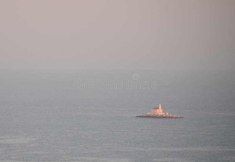 Farol no mar foto de stock royalty free