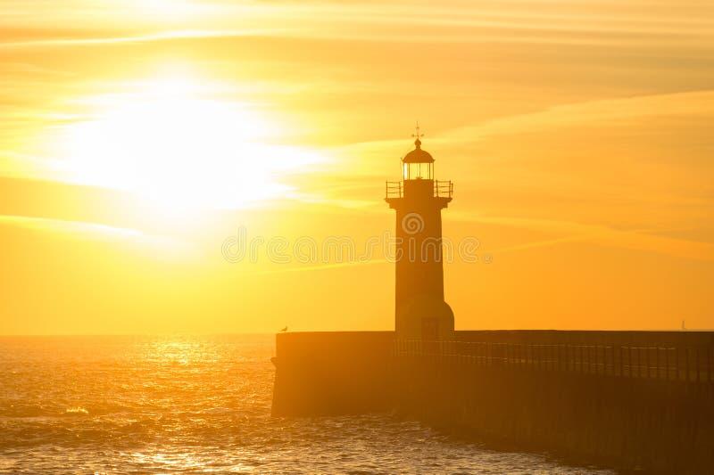 Farol no por do sol Porto, Portugal fotos de stock royalty free