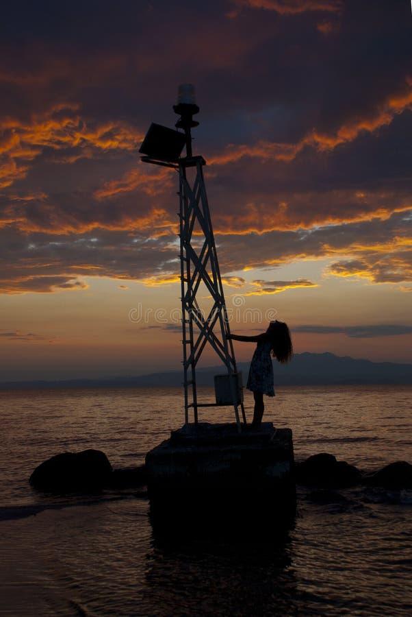 Farol - por do sol dramático foto de stock royalty free