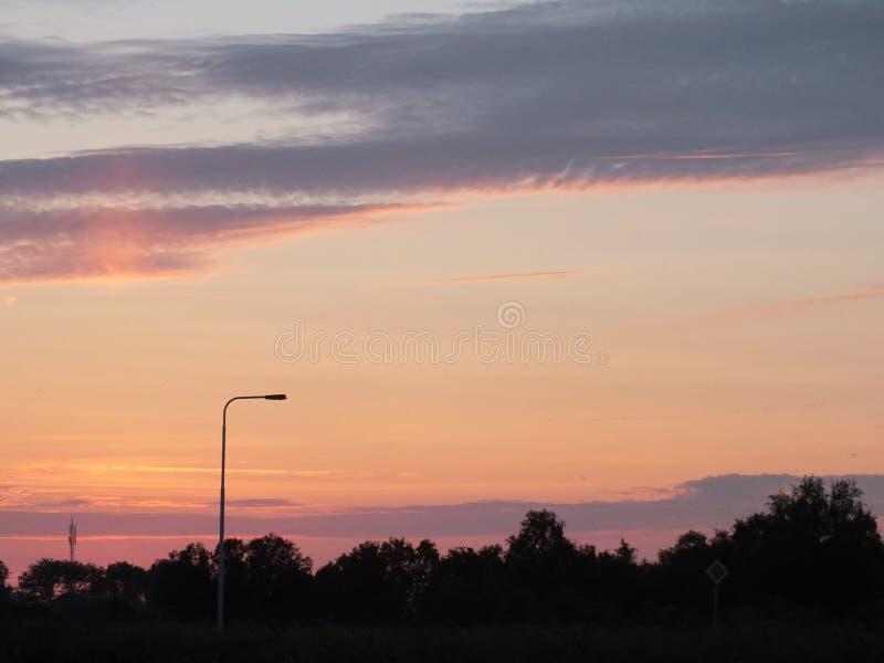 Farol por puesta del sol imagenes de archivo