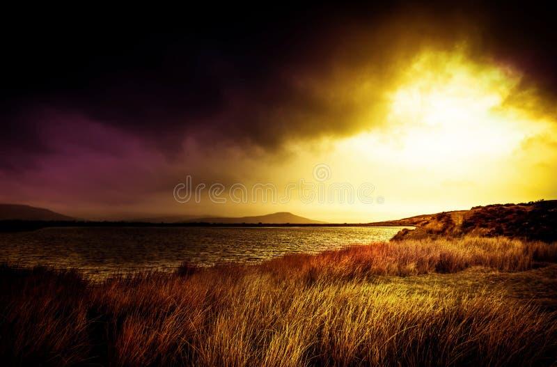Faros de Brecon del fondo del paisaje del resplandor solar fotografía de archivo