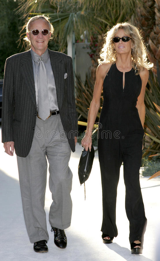 Farrah Fawcett and Jay Bernstein. HOLLYWOOD, CA - OCTOBER 05, 2005: Farrah Fawcett and Jay Bernstein at the remembering Rodney Dangerfield held at at the home of royalty free stock photography
