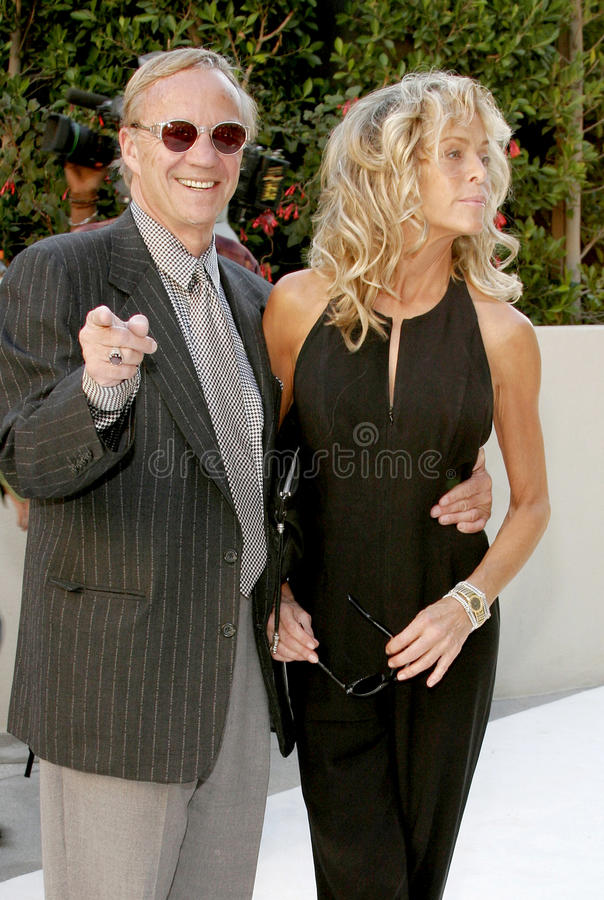 Farrah Fawcett and Jay Bernstein. HOLLYWOOD, CA - OCTOBER 05, 2005: Farrah Fawcett and Jay Bernstein at the remembering Rodney Dangerfield held at at the home of royalty free stock image
