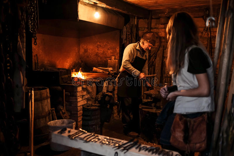Farrier at work in a forge stock photos