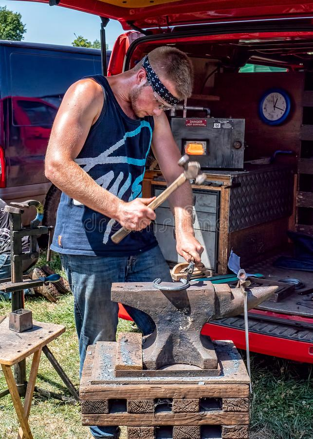 Farrier at work, Hanbury Countryside Show, Worcestershire, England. royalty free stock photography