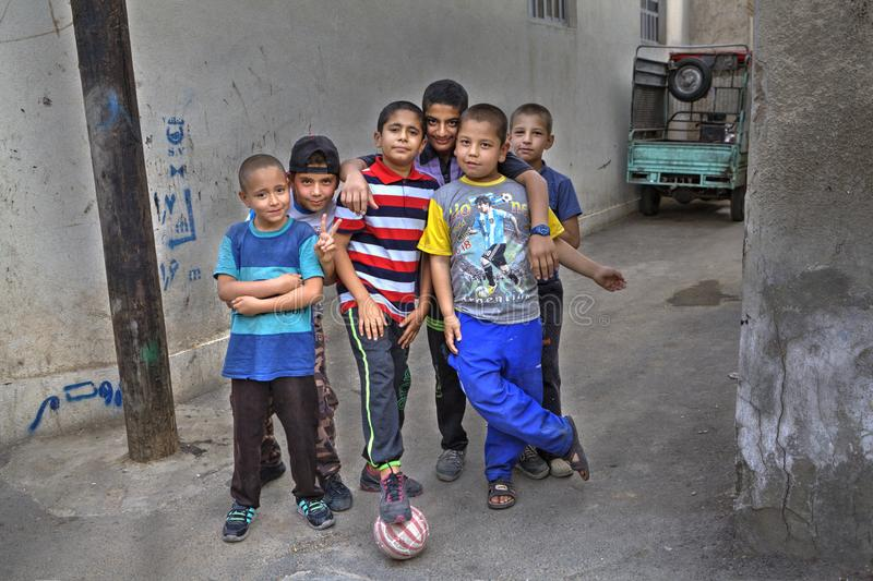 Group portrait of children yard football team, Shiraz, Iran. stock images