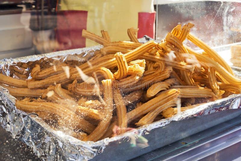 Farturas或油煎的面团Churros或者棍子在节日的 库存照片