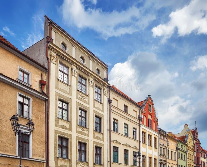 Fasady starzy tenement domy w Toruńskim starym miasteczku, Polska zdjęcie stock