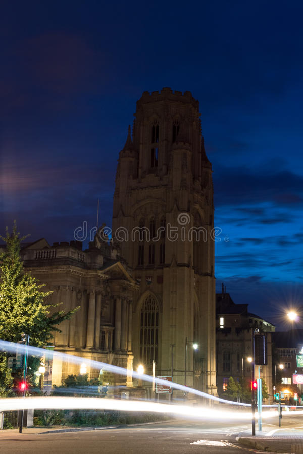 Fascade of WIlls Memorial Building by night. ENGLAND, BRISTOL - 13 SEP 2015: Fascade of WIlls Memorial Building by night, view with Bristol Museum and motion royalty free stock image