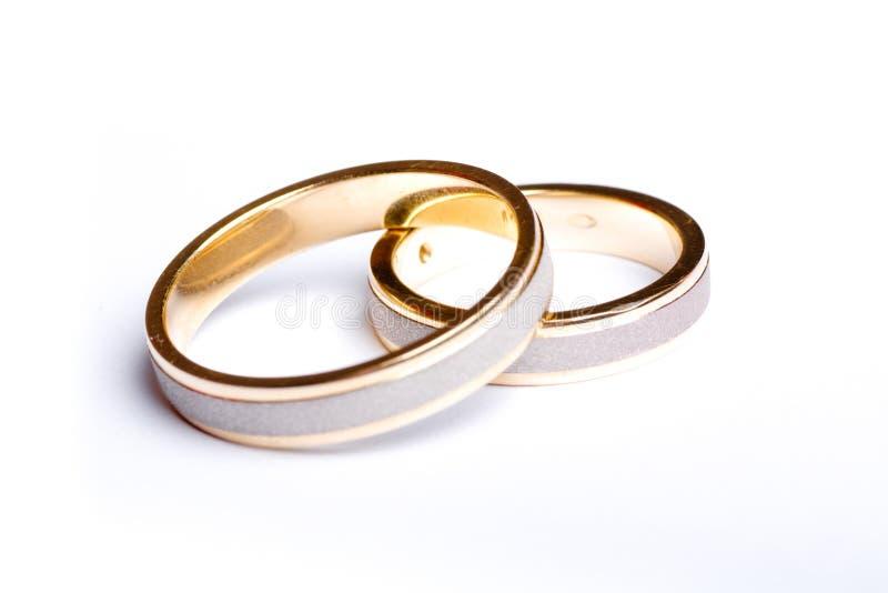 Fasce di cerimonia nuziale dell'oro immagini stock libere da diritti