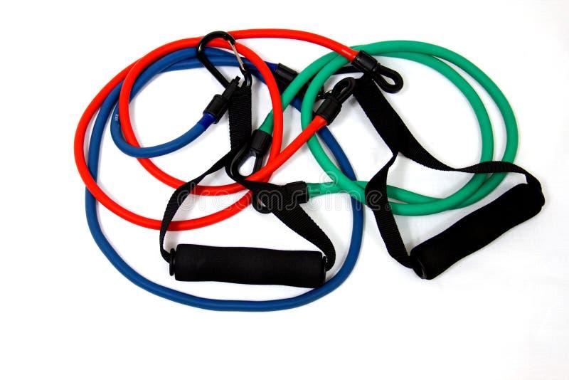 Fasce elastiche di esercitazione in rosso, in verde ed azzurro immagine stock libera da diritti