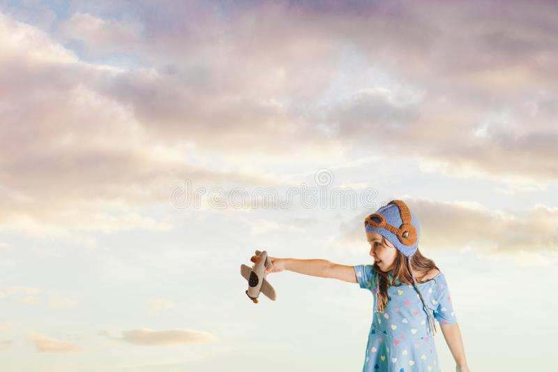 Fascinated girl with a toy airplane imagining her future profession royalty free stock images
