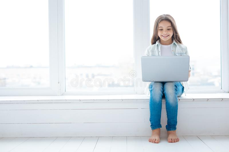 Fascinating adorable girl spending her leisure royalty free stock photos