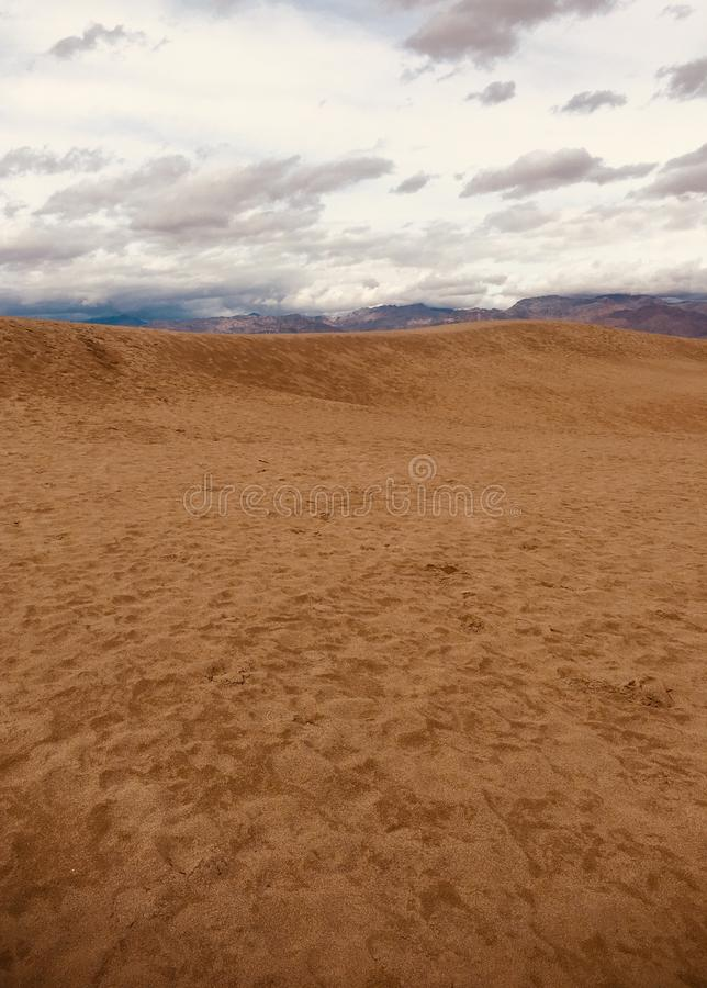 Sand Dunes in Death Valley National Park. Fascinating Red Sand Dunes in Death Valley Desert National Park-California stock photography