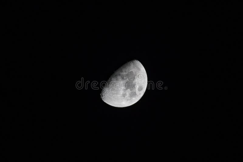 Fase de la luna del primer trimestre imagenes de archivo
