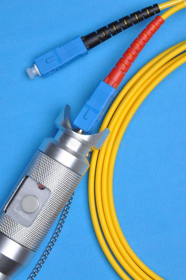 Faseroptikprüfvorrichtung und optisches Verbindungskabel stockbilder